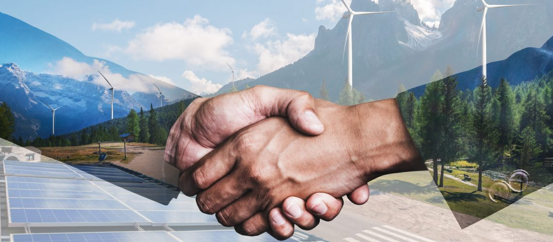 Double,Exposure,Graphic,Of,Business,People,Handshake,Over,Wind,Turbine