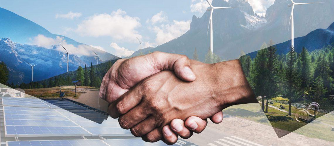 Double,Exposure,Graphic,Of,Business,People,Handshake,Over,Wind,Turbine